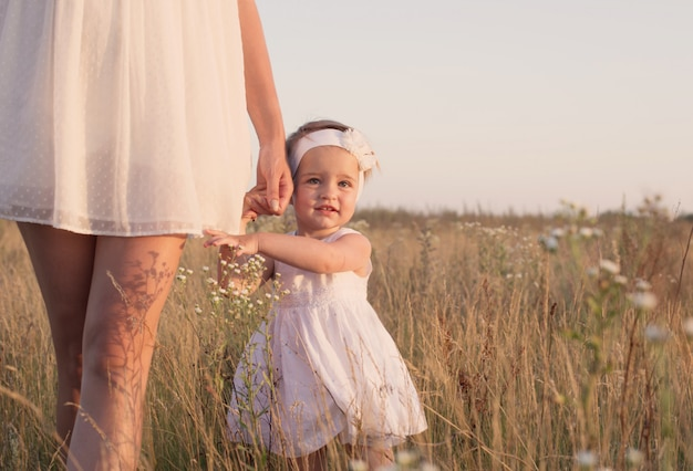 Mother and daugther at sunset