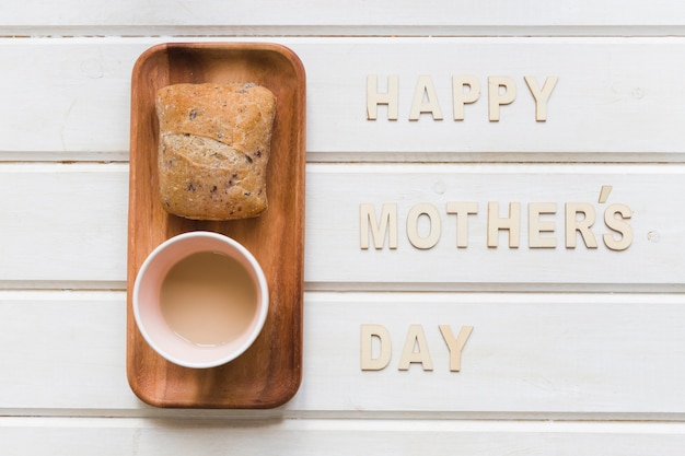Mother day composition with coffee and bread