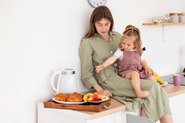 Mother and girl on countertop