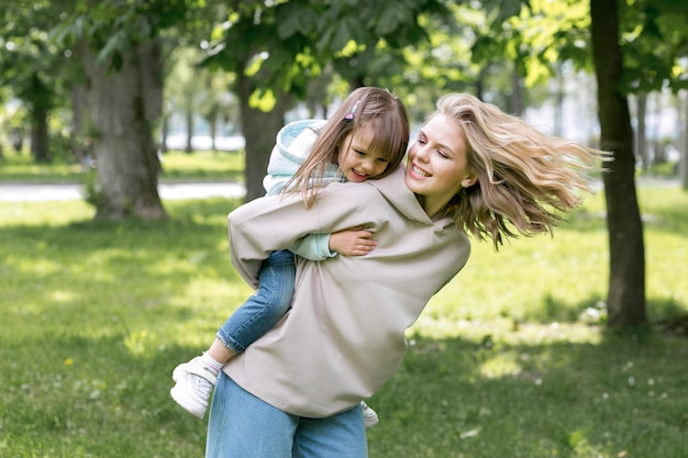 Mother and girl playing in the park
