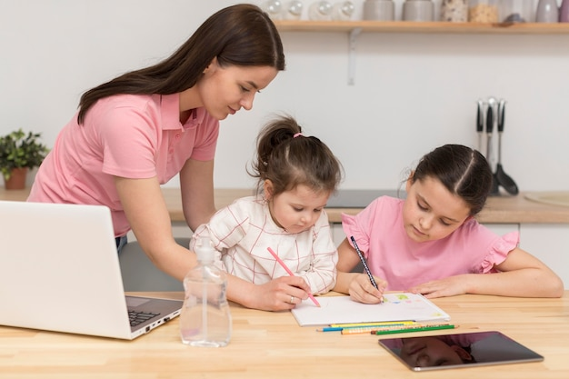 Mother and girls colouring