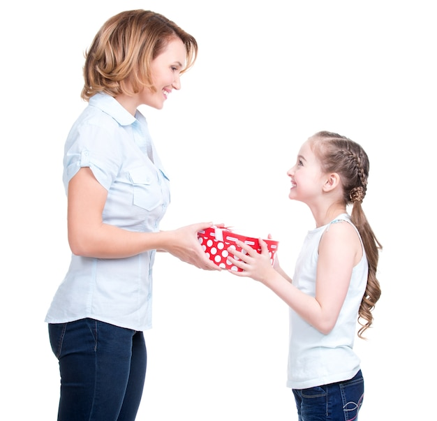 Mother gives a gift to her young daughter- isolated