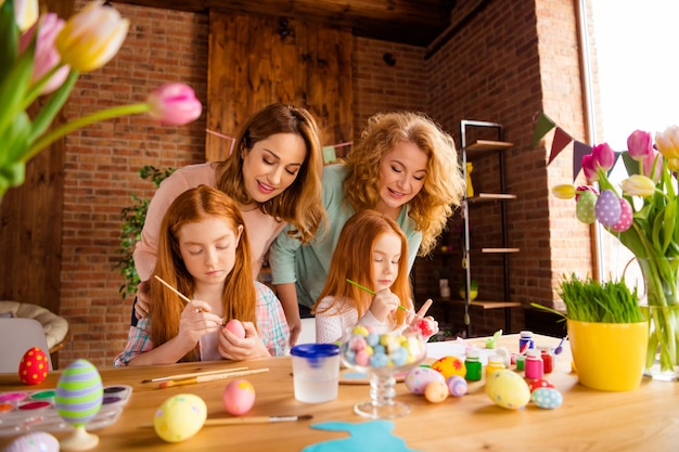 Mother and grandmother with children painting