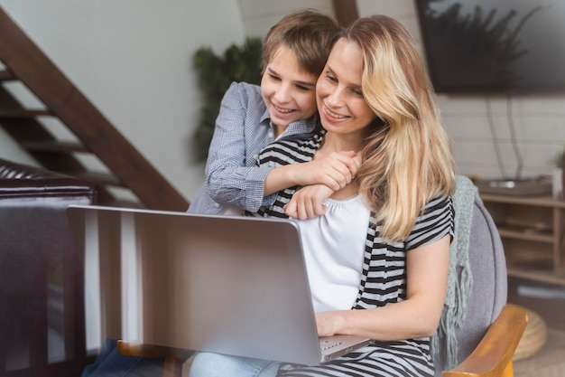 Mother happy to work from home with her son