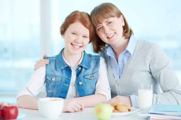 Mother having breakfast with her daughter