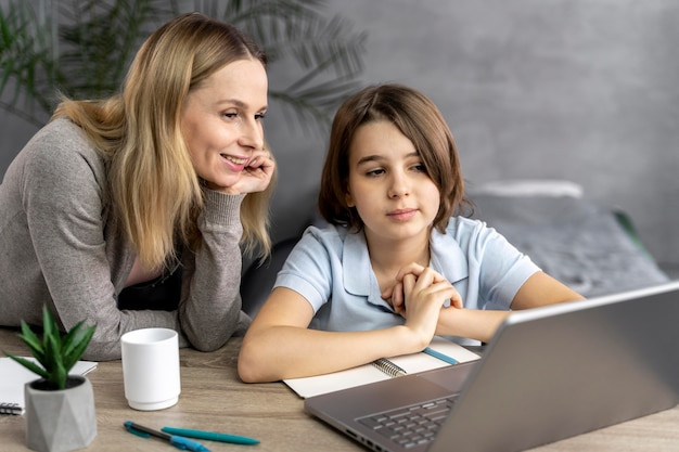 Mother helping daughter to study