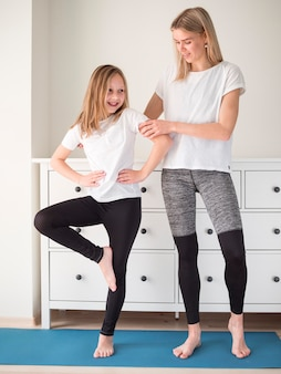 Mother helping girl to train