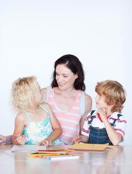 Mother helping her children doing homework