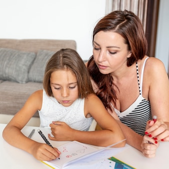 Mother helping with her daughter's homework