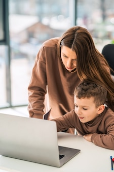 Mother helps son with online education