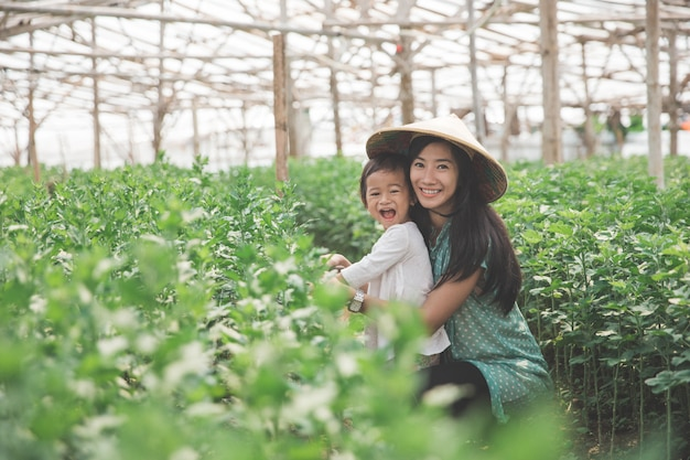 Mother and her daughter farming in the farm together