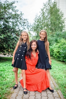 Mother and her daughters. adorable little girls