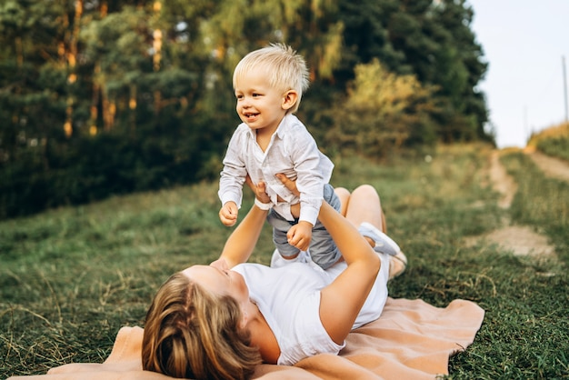 Mother and her little son have fun outdoor