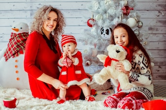 Mother in red dress with daughters