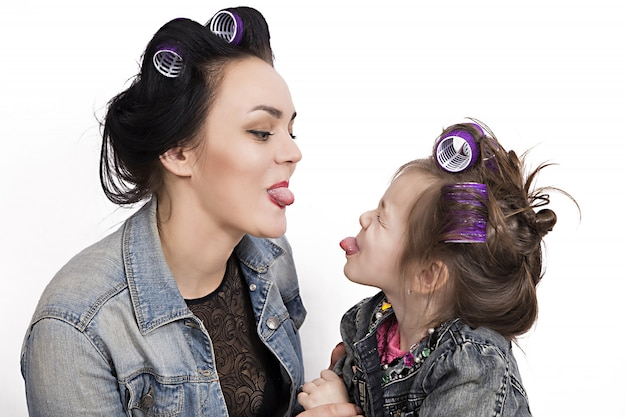 Mother and little daughter in hair curlers