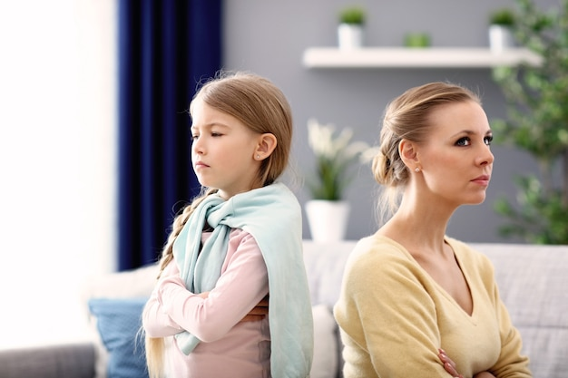 Mother and little daughter having argument at home