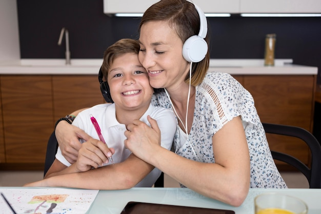 Mother proud of her son for finishing homework