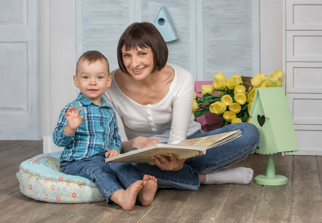 Mother reading book to her baby
