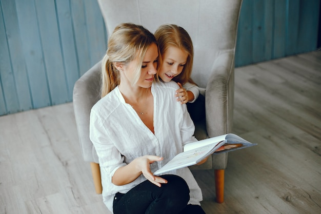 Mother reading a book with daughter