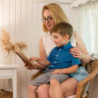 Mother reading to her son in a caravan