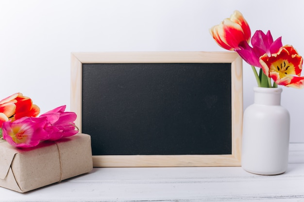 Mother's day concept. chalkboard with flowers.