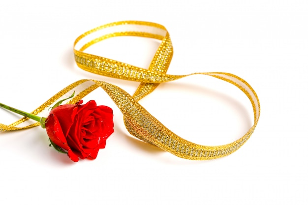 Mother's day concept, red rose and golden ribbon