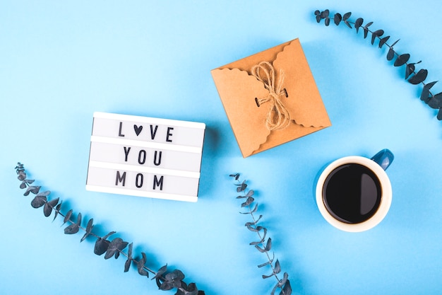 Mother's day layout with coffee and eucalyptus.