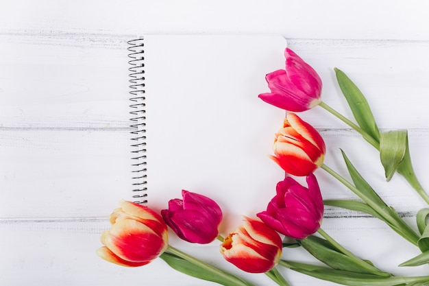 Mother's day. pink tulips and notebook with copy space.