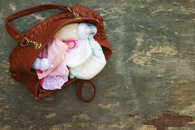 Mother's handbag with items to care for child.