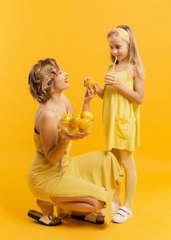 Mother showing her daughter lemons