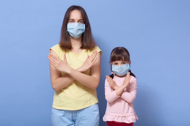 Mother and small girl with pigtails wearing medical protective masks Premium Photo