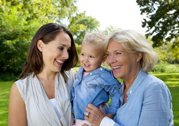 Mother smiling with baby and grandmother