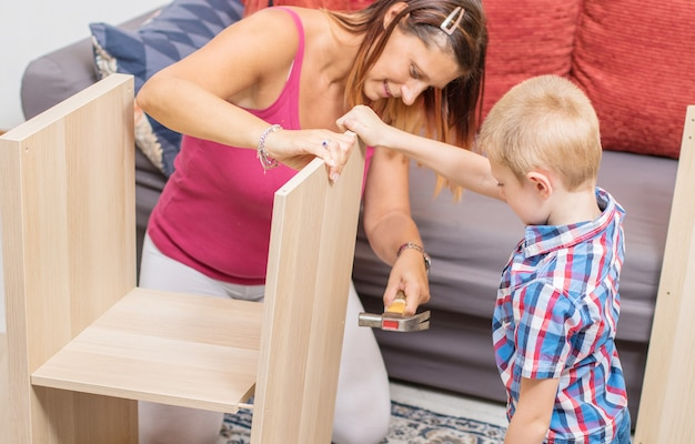 Mother and son are building the furniture