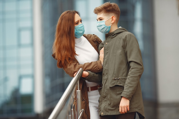 Mother and son are wearing disposable masks