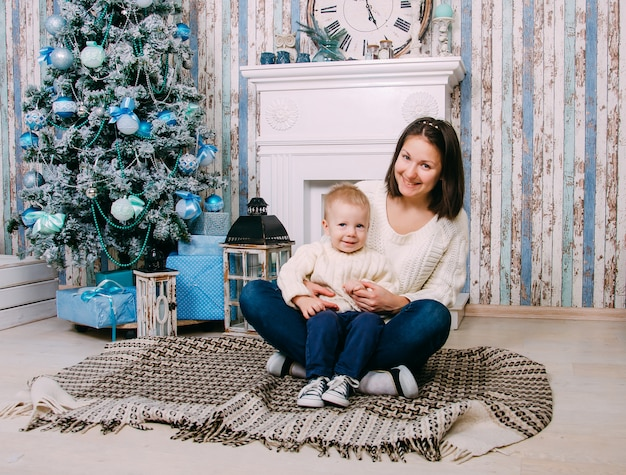 Mother and son in decorated home for christmas