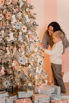 Mother and son decorating the christmas tree concept