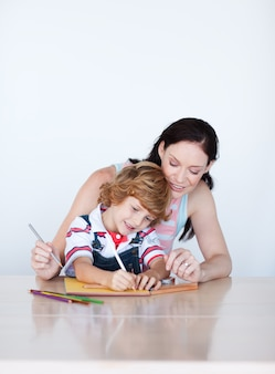 Mother and son doing homework with copy-space