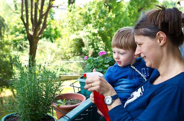 Mother and son gardening plant