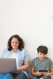 Mother and son looking on laptop