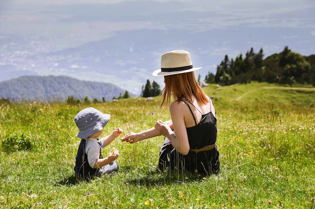 Mother and son on the nature background. lifestyle, travel, family concept.