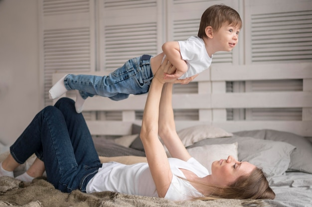 Mother and son playing airplane game