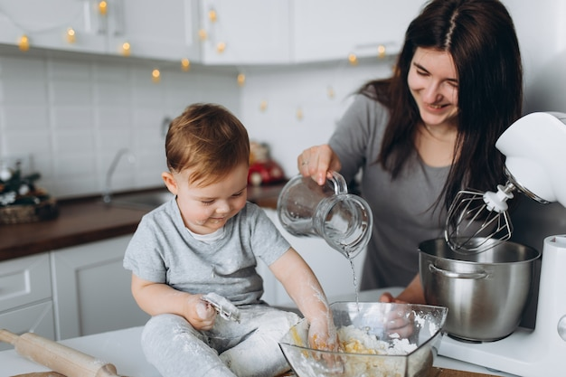 Mother and son preparing the dough