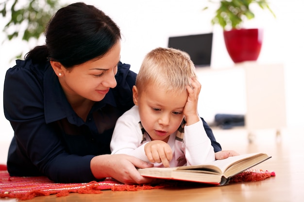 Mother and son reading together