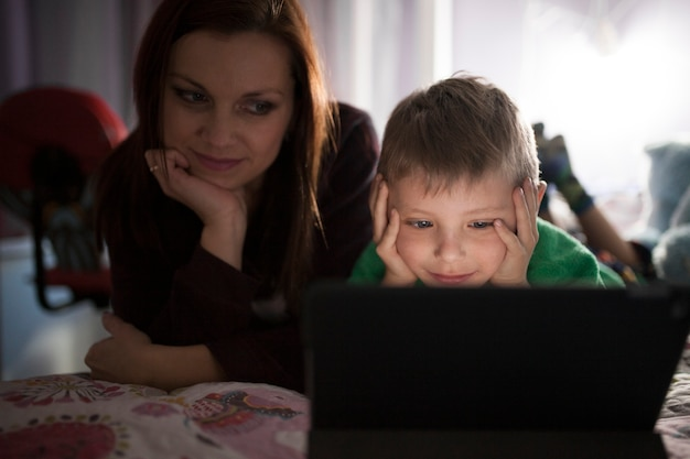 Mother and son watching movie on tablet