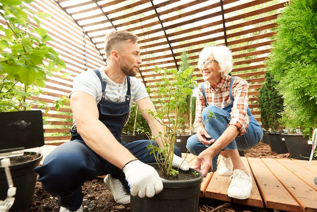Mother and son working in garden