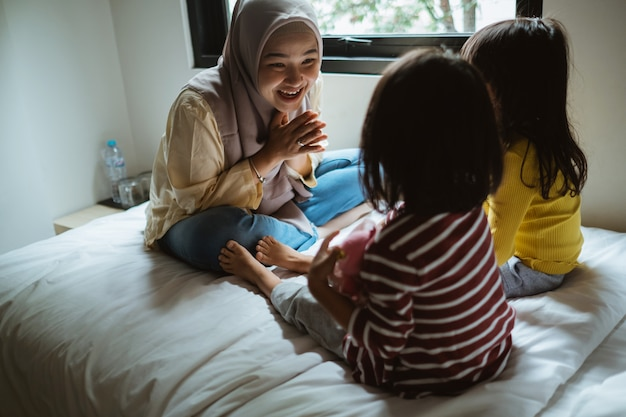 Mother storytelling to her daughters