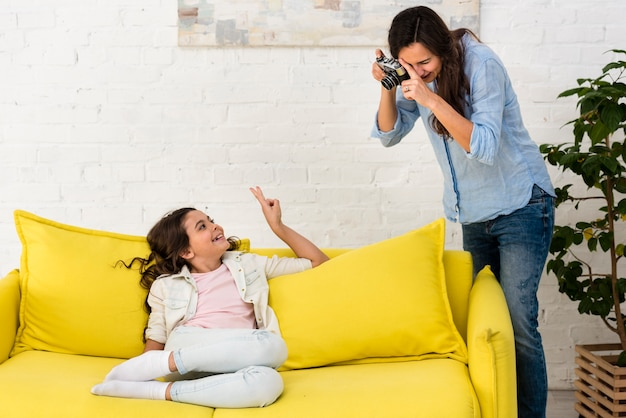 Mother taking a photo of her daughter