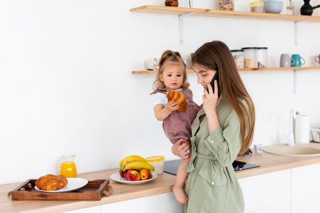 Mother talking on the phone in kitchen