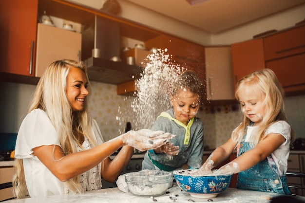Mother throwing flour on her children