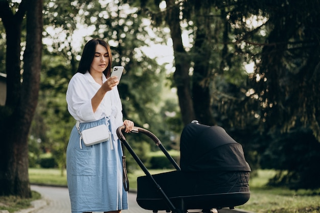 Mother walking with her baby daughter in park